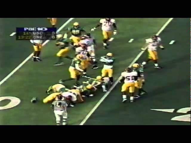 Oregon safety Michael Fletcher drops USC RB Chad Morton for no gain 10-24-98
