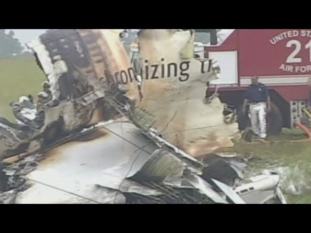 Alabama cargo plane crash: Smouldering wreckage in daytime