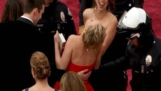 Jennifer Lawrence FALLS on Oscars Red Carpet 2014!