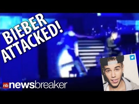 CAUGHT ON TAPE: Pop Star Justin Bieber Attacked On Stage; Fan Tackled | NewsBreaker | Ora TV