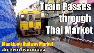 Train passes through Thai Market