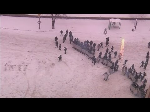 Ukraine clashes: Snow falls on protesters as grenades are thrown