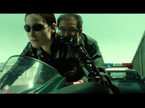 The Matrix Reloaded: Trinity on her Ducati motorcycle (HD), Trinity on her Ducati motorcycle. Carrie-Anne Moss as Trinity. The Matrix Reloaded (2003)