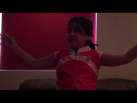 Little Indian girl dancing on Chinese Song