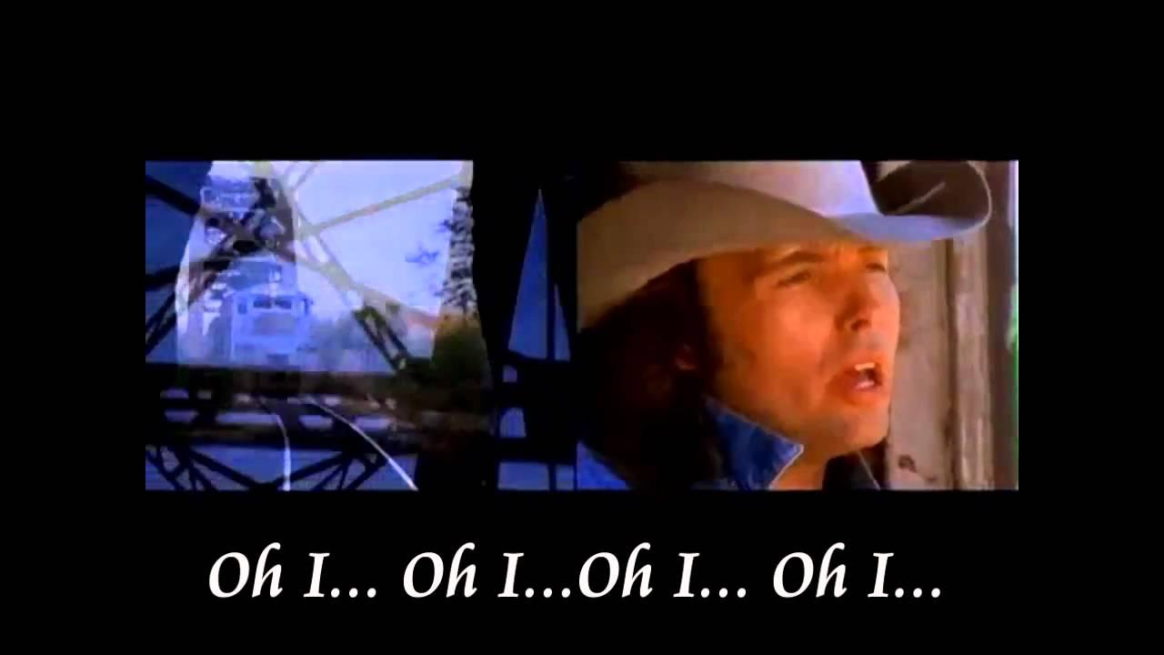 Dwight Yoakam – A Thousand Miles From Nowhere Lyrics ...