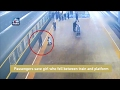 Shocking video : Passengers save girl who fell between tra..