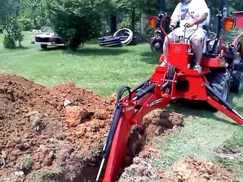 Digging trench with Massey Ferguson GC 2410 TLB