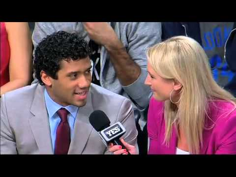 Super Bowl Champion Seattle Seahawks' Russell Wilson court-side at Nets' game