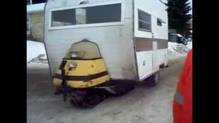 Camper With A Skidoo On It