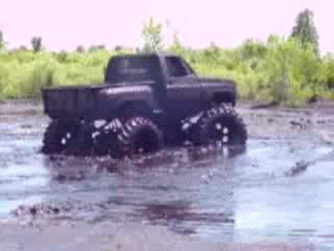bad ass chevy 4x4 stepside slinging mud