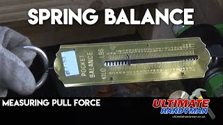 Measuring pull force using a spring balance