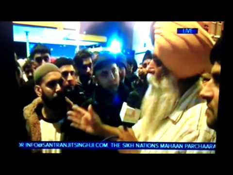 Sangat TV UK riots - Muslim youths with Mr. Singh from Sangat TV in the Midlands