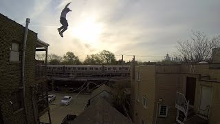 Stuntman Jumps from Tall Building and Slides Down Steep Gable Roof, Rips Jeans