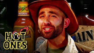 Coyote Peterson Gets STUNG by Spicy Wings   Hot Ones
