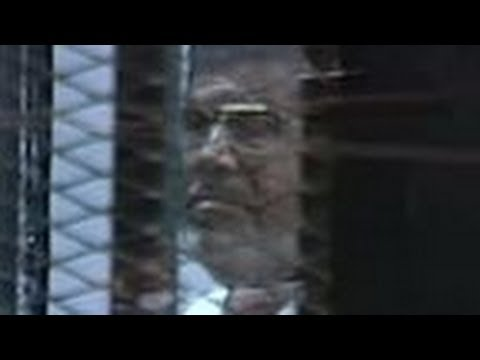Egypt ex President Morsi paces and rants in glass cage
