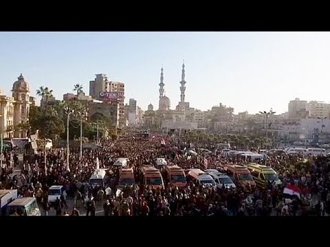 Thousands of Egyptians mourn police HQ bomb victims