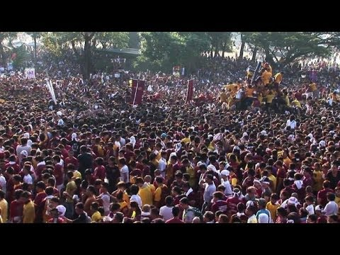 Barefoot devotees in spectacular Catholic parade
