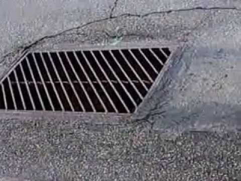 relaxing sound of flowing water into storm drain