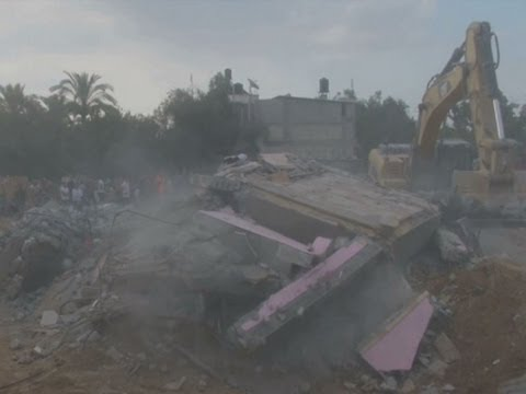 Bulldozers and rescue crews were clearing rubble on Monday from a building in southern Gaza that was hit by an Israeli airstrike on Sunday evening, killing 25 members of the same family, according to Palestinian health officials. (July 21)  Subscribe for more Breaking News: http://smarturl.it/AssociatedPress