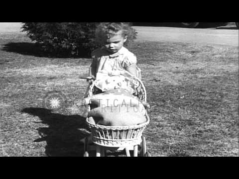 Patsy Grimmett a two and a half years old girl with a big cigar in her hand in a ...HD Stock Footage