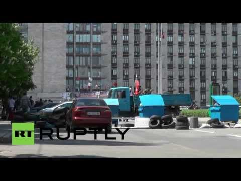 Ukraine: Seized APC on show outside Donetsk People's Republic HQ