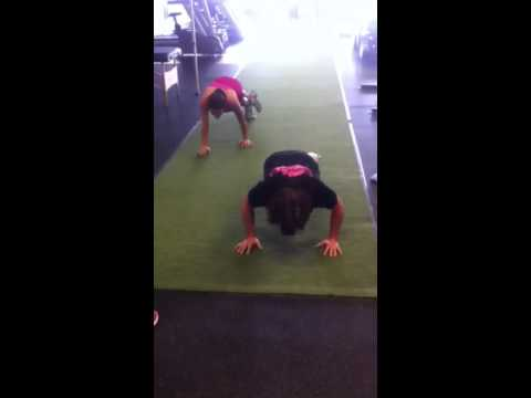 Tracy and Nan turf walking planks followed by push-ups