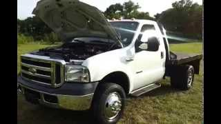 SOLD.2005 FORD F-350 SUPER DUTY REGULAR CAB CHASSIS 4X4 9' CM FLAT BED 6.0 DIESEL CALL 888-439-8045 videos