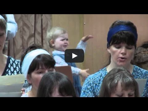 Девочка руководит хором: mini maestro - church choir conductor, Kyrgyzstan