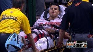Machado injures knee, exits on stretcher