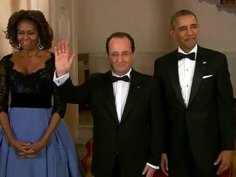 President Obama salutes Hollande at star-studded dinner