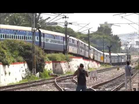 TRAIN DESCENDS A FLY-OVER ( INDIAN RAILWAYS)