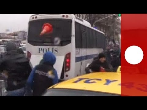 Police bus attack and tear gas fired as clashes erupt in Ankara, Turkey
