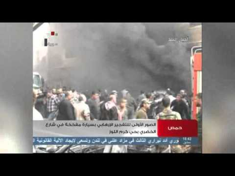 Raw: Two Car Bombs Explode in Homs, Syria