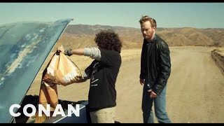 Conan Drives an Explosives Packed Car Off