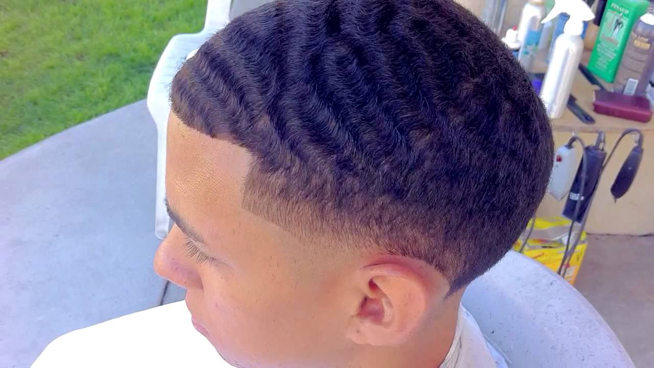 waves with taper fade haircut
