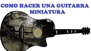 Guitarra acústica en miniatura