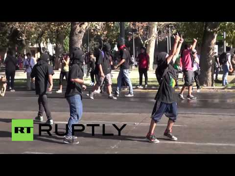 Chilean police fight protesters with water cannon