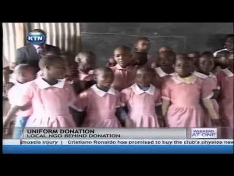 School children in Kibera slum jubilant after receiving  uniform donation