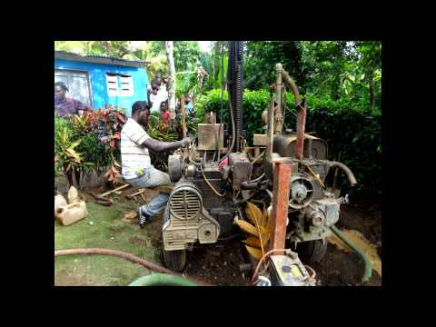 Drilling water well in Haiti John McCombie