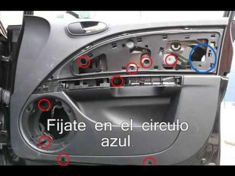 Seat León II. Desmontar el panel de la puerta. -
