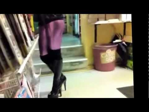 LotLot Walking In Black Shiny Platue Knee Boots And Purple Shiny Leggings
