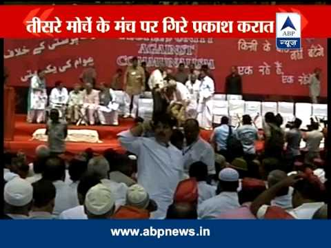 Prakash Karat falls from the dais at Third Front meet