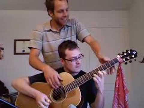Vidéo de guitare à quatre mains