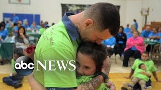 Children of Prisoners Reunite with their Fathers Behind Bars for a Day