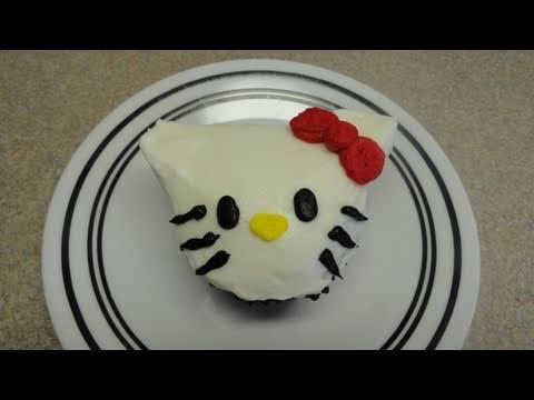 Decorating Cupcakes #48: Hello Kitty, I received many requests for Hello Kitty cupcakes, so here it is! Found the idea for the Hello Kitty cupcakes in this video: http://www.youtube.com/watch?v=l...