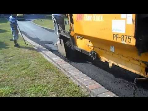ASPHALT PAVEMASTERS INC  from northern virginia  IN ACTION ON  A DRIVEWAY  WITH BRICK PAVER EDGES