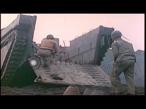Disarmed anti-tank and personnel mines are loaded aboard an LCVP by the Bomb and ...HD Stock Footage