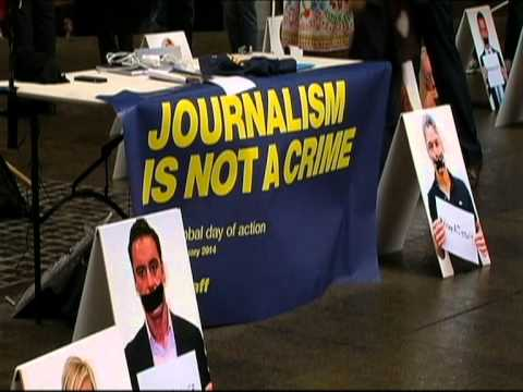 Protesters call for release of four al Jazeera journalists detained in Cairo