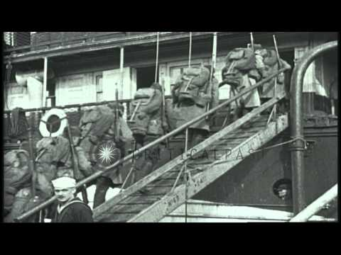US troops embark onto a ship at a port in Europe, bound for home after World War ...HD Stock Footage