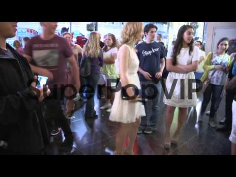 Dove Cameron greets fans while departing the Monsters Uni...